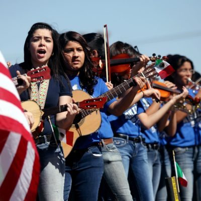 Members of the Ector Junior High Mariachi Band perform while riding on a float Saturday, May 3, 2014 during the Cinco de Mayo parade on Crane Avenue in Odessa, Texas. Cinco de Mayo marks the Battle of Puebla on May 5, 1862, when Mexican troops defeated a French army of Napoleon III, then considered the mightiest military in the world. It is considered a bigger holiday in the U.S., celebrating Mexican heritage in many cities. (AP Photo/Odessa American, Edyta Blaszczyk)