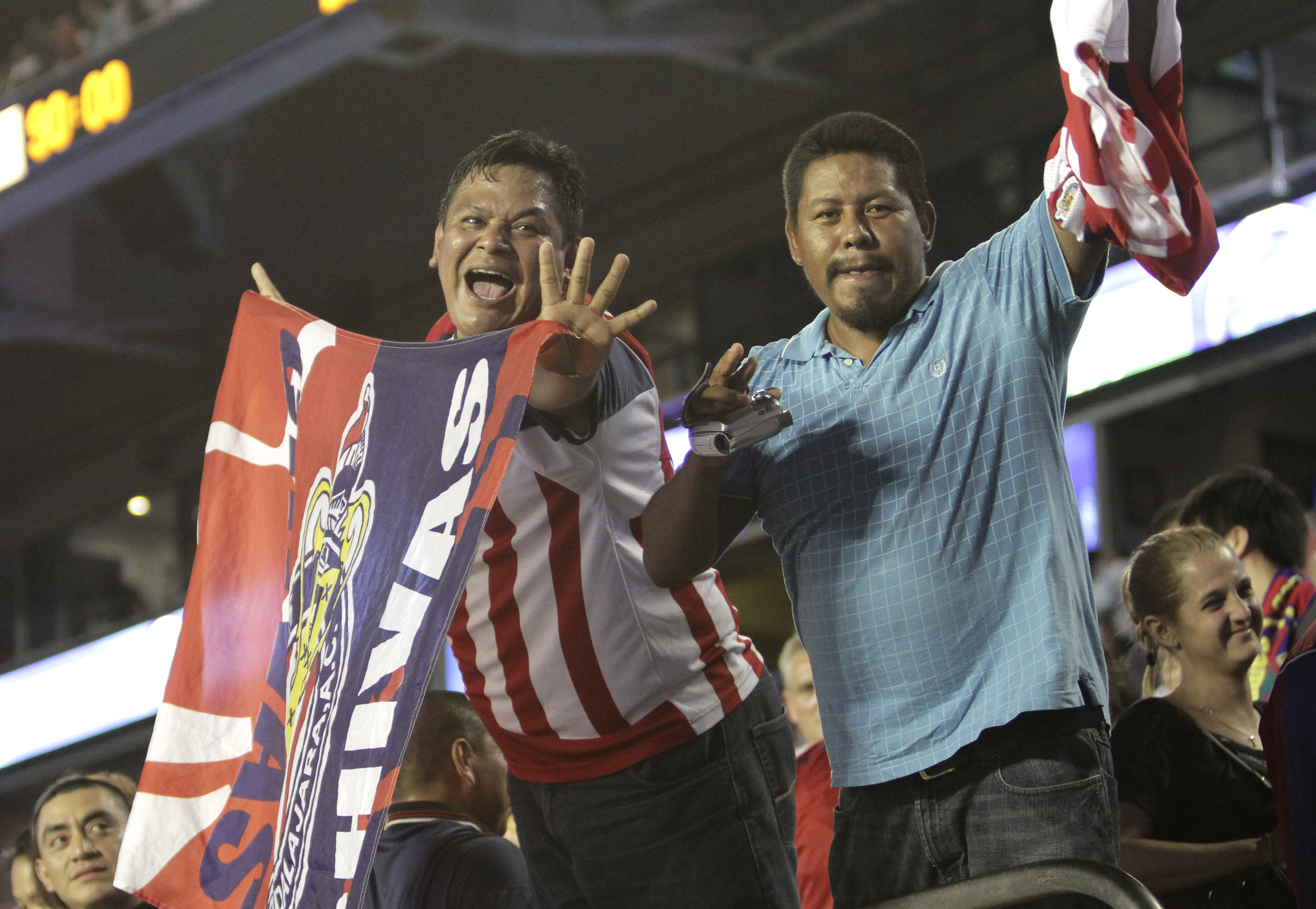 Mexico's los Chivas de Guadalajara fans celebrate after the Football Challenge Match soccer game against FC Barcelona in Miami, Wednesday, Aug. 3, 2011 against FC Barcelona. Guadalajara won 4-1. (AP Photo/J Pat Carter)