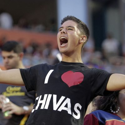 An unidentified fan of Mexico's los Chivas de Guadalajara celebrates after the Football Challenge Match soccer game against FC Barcelona in Miami, Wednesday, Aug. 3, 2011. Guadalajara won 4-1. (AP Photo/J Pat Carter)