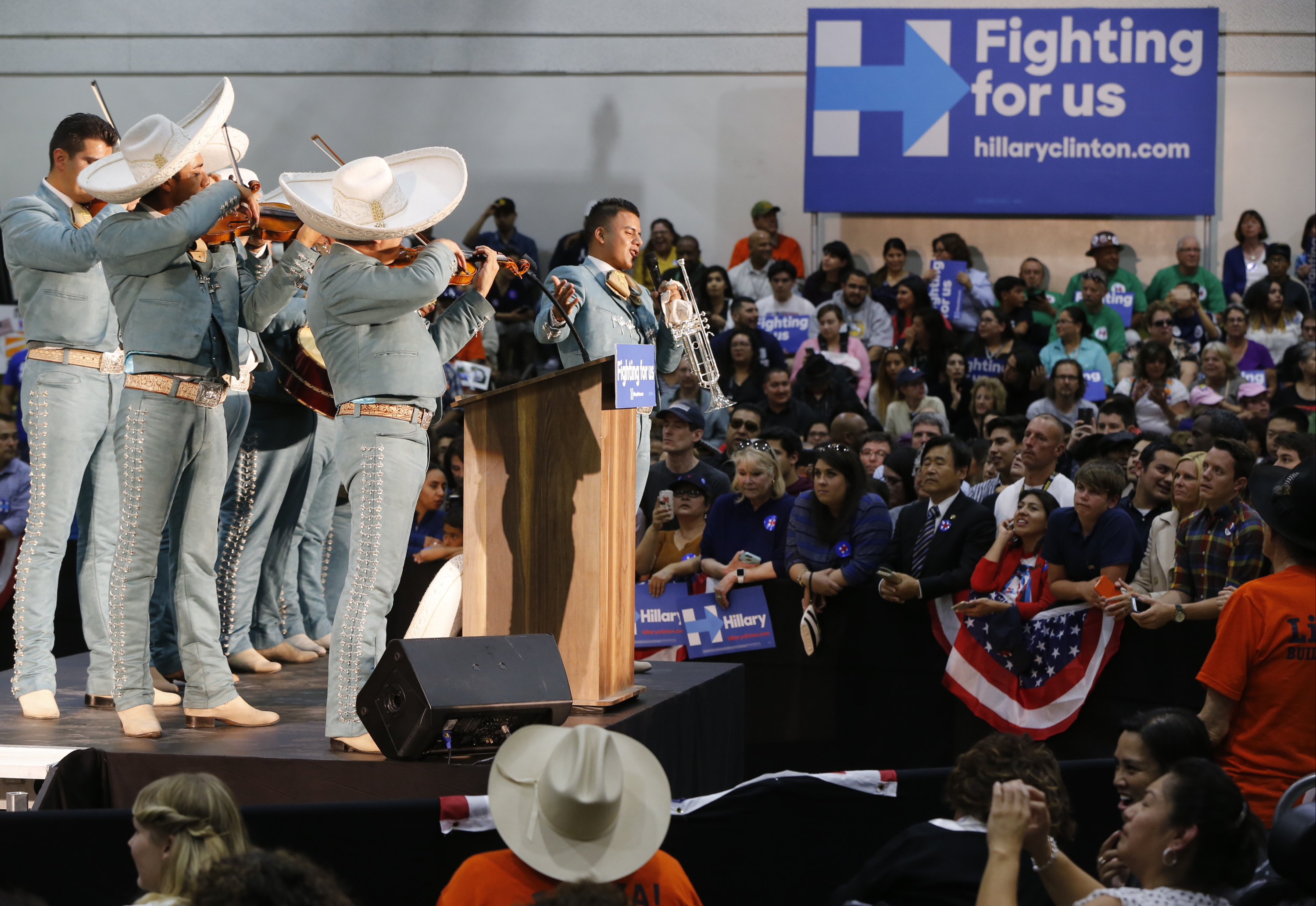 A mariachi band performs at an event of Democratic presidential candidate Hillary Clinton campaign at East Los Angeles College in Los Angeles, Thursday, May 5, 2016. (AP Photo/Damian Dovarganes)