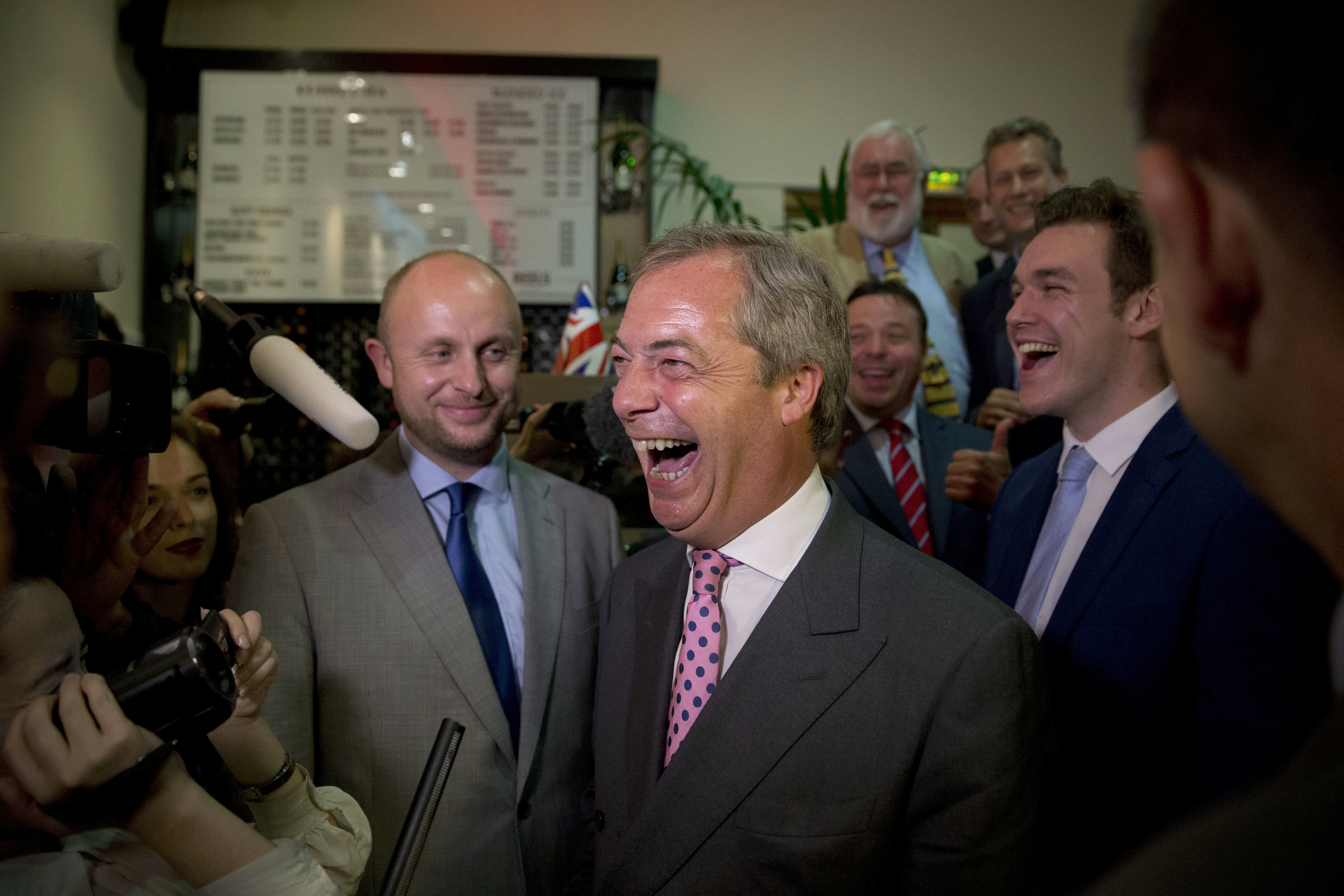 """Nigel Farage, the leader of the UK Independence Party, reacts in celebration at a """"Leave.EU"""" organization party for the British European Union membership referendum in London, Friday, June 24, 2016. Farage said he thinks the """"leave"""" side will win in Britain's historic referendum on European Union membership. (AP Photo/Matt Dunham)"""