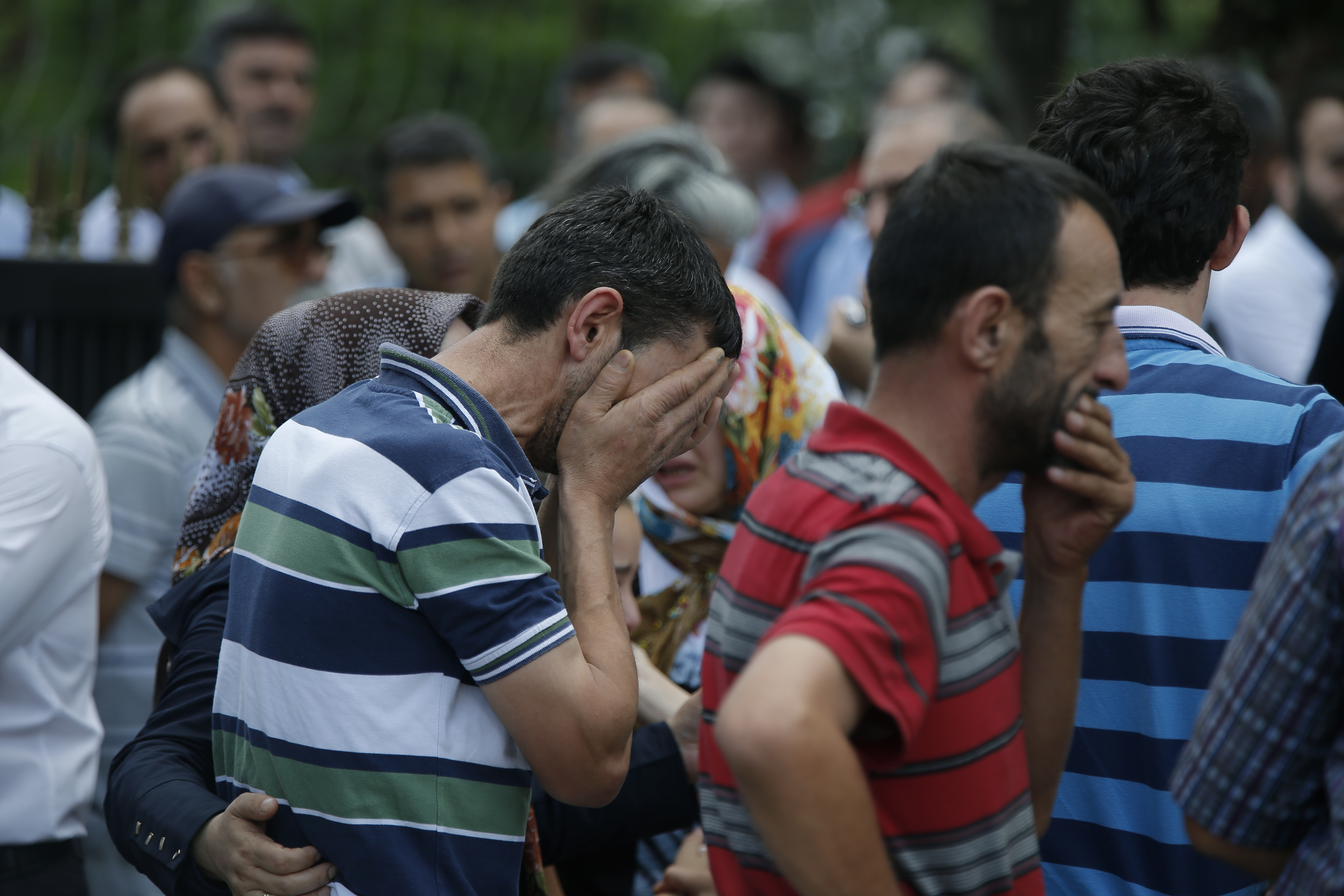 Family members of victims cry outside the Forensic Medical Center in Istanbul, Wednesday, June 29, 2016. Suicide attackers killed dozens and wounded more than 140 at Istanbul's busy Ataturk Airport late Tuesday, the latest in a series of bombings to strike Turkey in recent months. Turkish officials said the massacre was most likely the work of the Islamic State group. Turkish authorities have banned distribution of images relating to the Ataturk airport attack within Turkey.(AP Photo/Emrah Gurel) TURKEY OUT