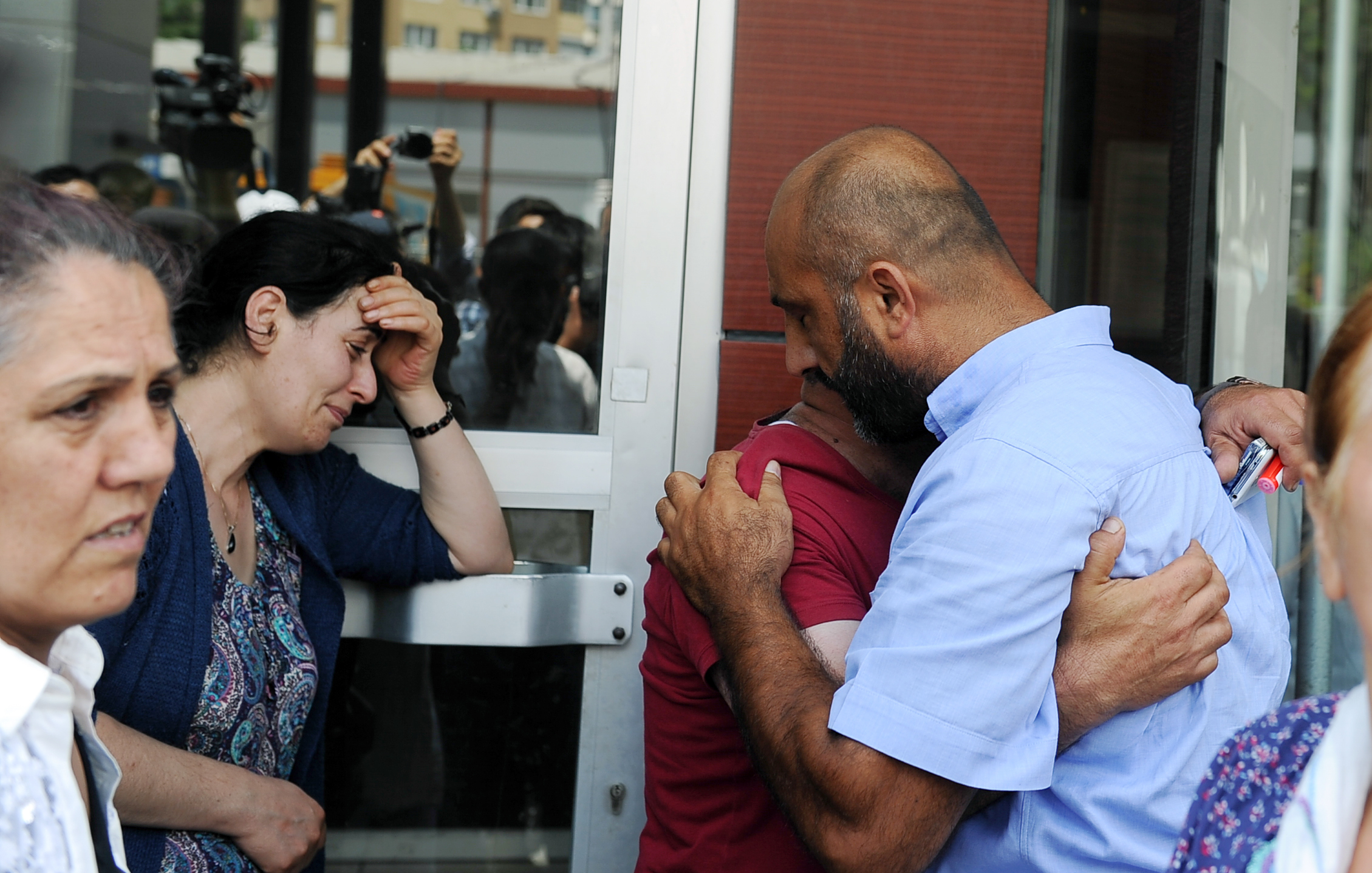 Family members of victims cry outside the Bakirkoy State Hospital in Istanbul, Wednesday, June 29, 2016. Suicide attackers killed dozens and wounded more than 140 at Istanbul's busy Ataturk Airport late Tuesday, the latest in a series of bombings to strike Turkey in recent months. Turkish officials said the massacre was most likely the work of the Islamic State group. Turkish authorities have banned distribution of images relating to the Ataturk airport attack within Turkey. (AP Photo/Omer Kuscu) TURKEY OUT