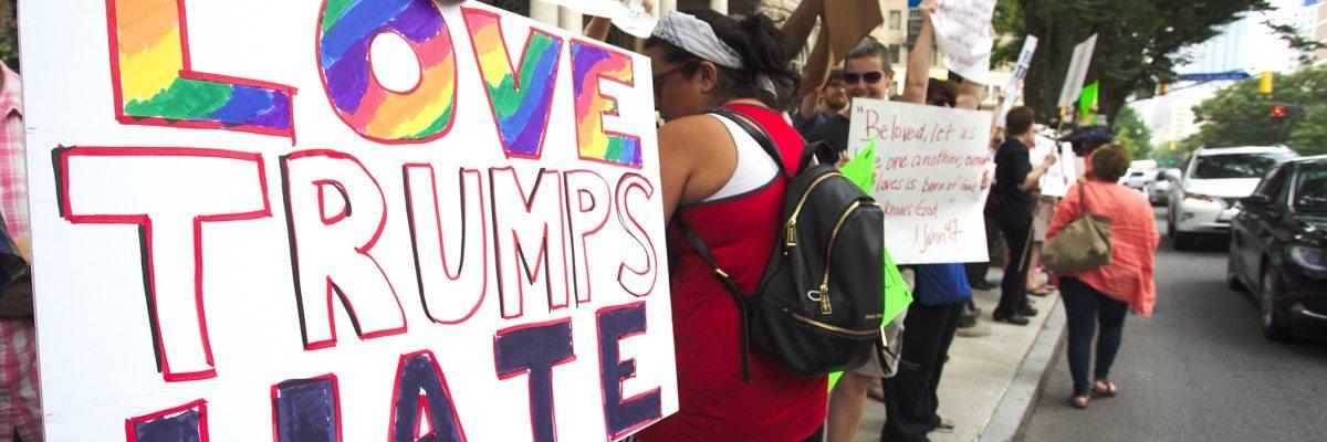 Protestors demonstrate near the historic Fox Theatre before Republican presidential candidate Donald Trump speaks, Wednesday, June 15, 2016, in Atlanta. (AP Photo/Ron Harris)