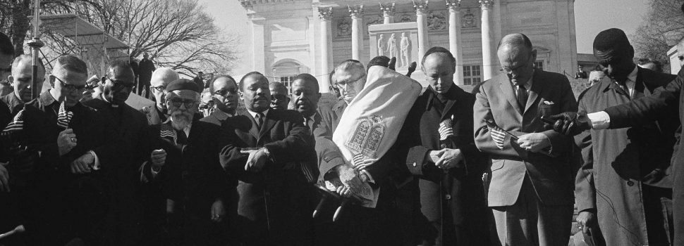 Leaders in a Vietnam war protest stand in silent prayer in Arlington National Cemetery, Feb. 6, 1968. Front row, from left: Rev. Andrew Young, executive vice president of the Southern Christian Leadership Conference; Bishop James P. Shannon, Roman Catholic auxiliary bishop of Minneapolis and St. Paul; Rabbi Abraham Heschel, professor at the Jewish Theological Seminary, New York; the Rev. Dr. Martin Luther King Jr., and Rabbi Maurice Eisendrath, president of the Union of American Hebrew Congregations. The Tomb of the Unknown Soldier and Arlington Amphitheater are in background. (AP Photo/Harvey Georges)