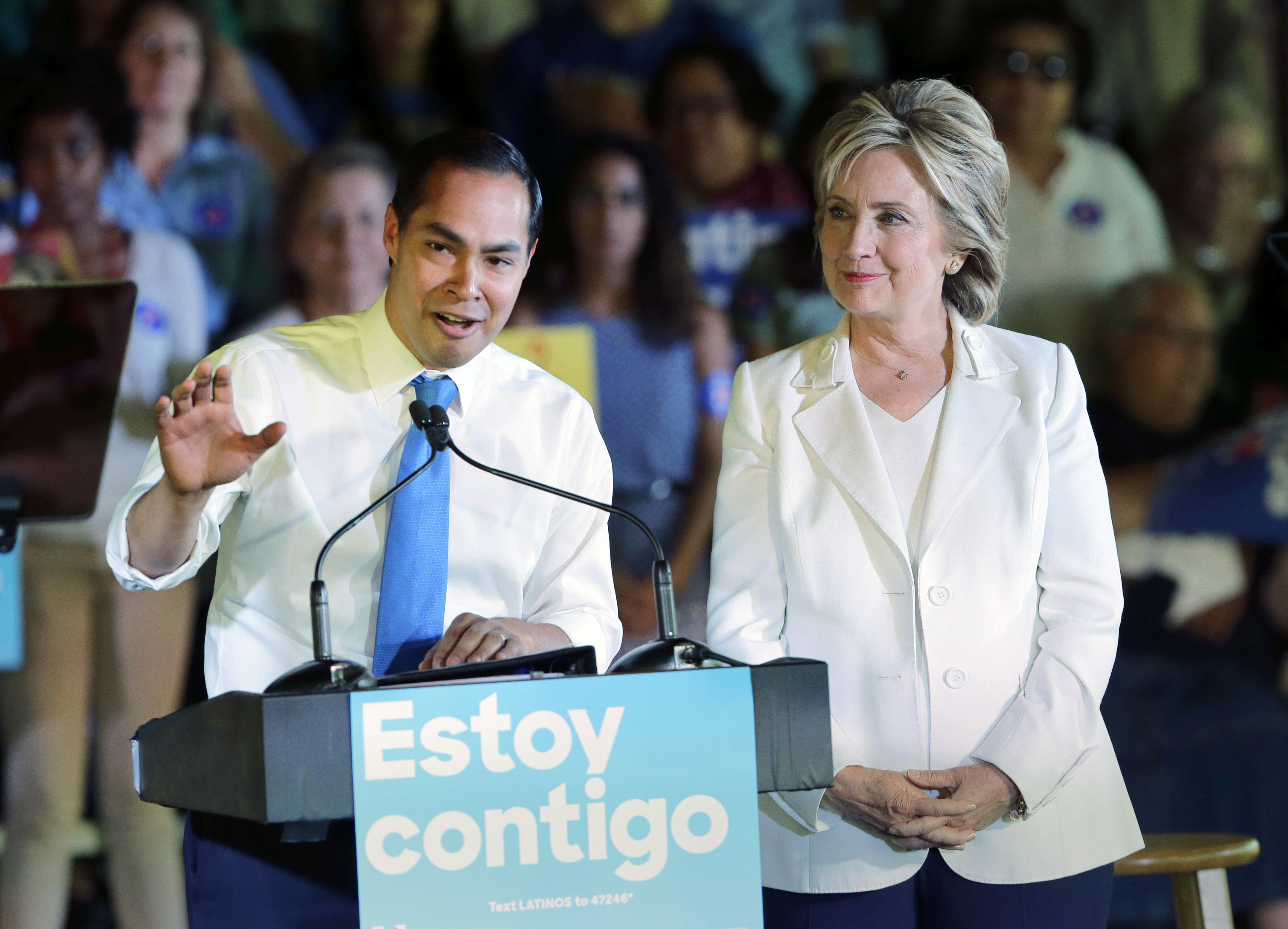 FILE - In this Oct. 15, 2015 file photo, Housing and Urban Development Secretary Julian Castro, left, speaks during a campaign event for Democratic presidential candidate Hillary Rodham Clinton, right, in San Antonio. Castro is returning home Friday, June 17, 2016, swarmed by the same speculation about whether he could be Hillary Clinton's running mate this fall. (AP Photo/Eric Gay, File)