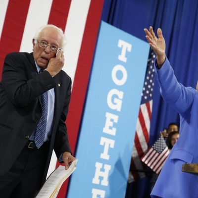 Democratic presidential candidate Hillary Clinton, accompanied by Sen. Bernie Sanders, I-Vt., speaks at a rally in Portsmouth, N.H., Tuesday, July 12, 2016, after Sanders introduced her and endorsed her for president. (AP Photo/Andrew Harnik)