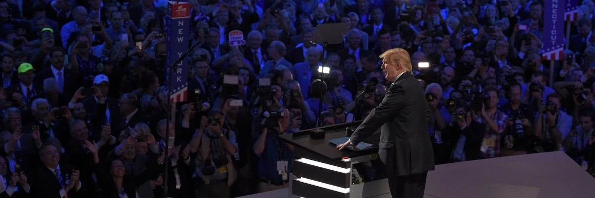 Republican Presidential Candidate Donald Trump steps to the podium to introduce his wife Melania during the opening day of the Republican National Convention in Cleveland, Monday, July 18, 2016. (AP Photo/Mark J. Terrill)