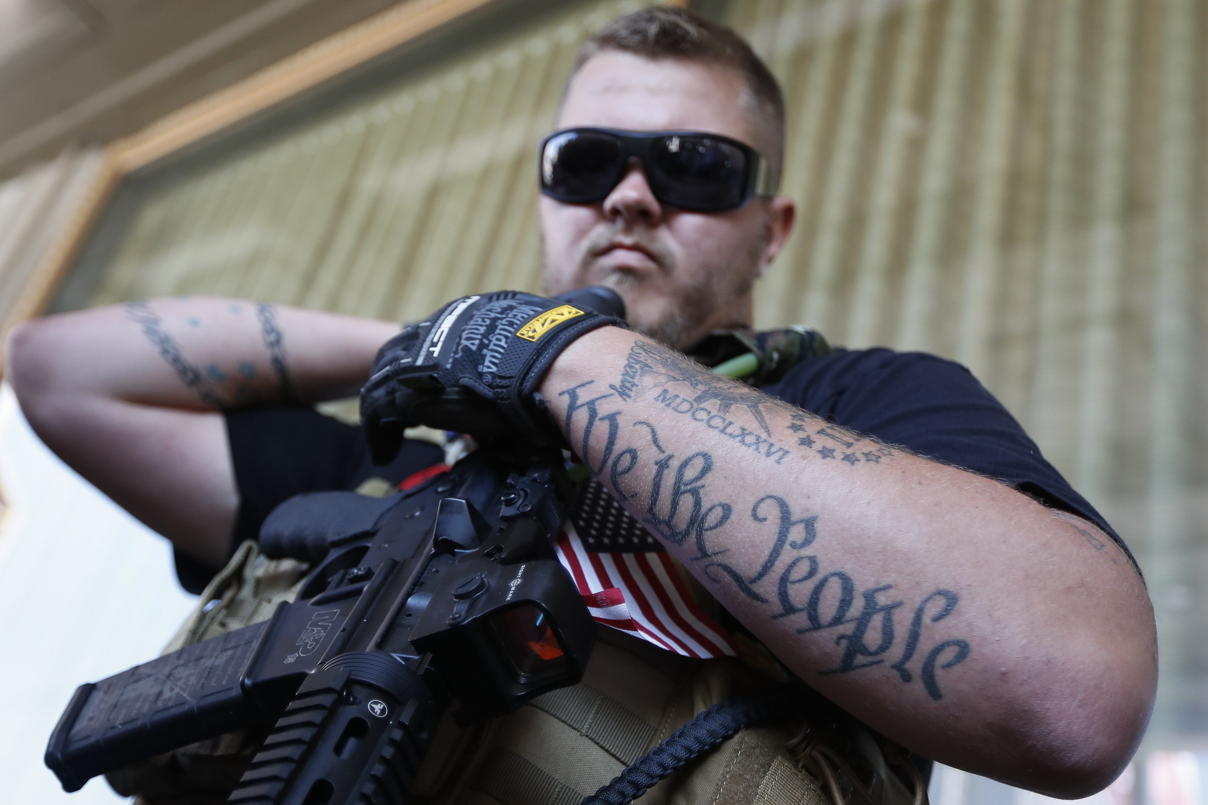 Trevor Leis, exercising his Ohio open carry rights, stands armed in Public Square on Tuesday, July 19, 2016, in Cleveland, during the second day of the Republican National Convention. (AP Photo/John Minchillo)