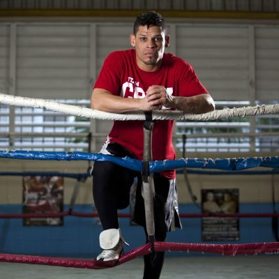 Boxer Orlando Cruz poses for pictures after a training session at a public gym in San Juan, Puerto Rico, Thursday, Oct. 4, 2012. Describing himself as