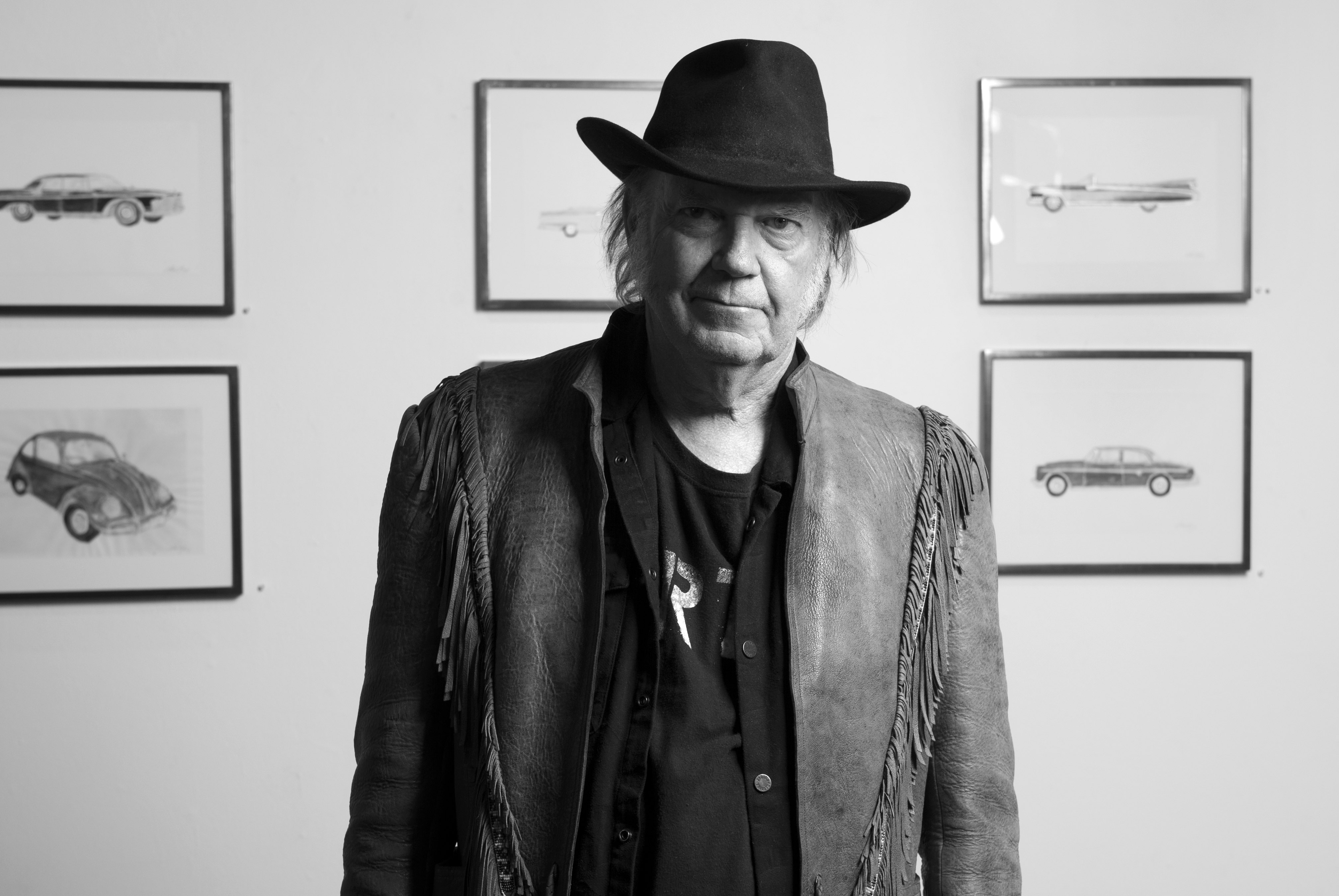 "Neil Young poses for a portrait at the opening reception for his art show ""Special Deluxe"" at the Robert Berman Gallery on Monday, Nov. 3, 2014, in Santa Monica, Calif. (Photo by John Shearer/Invision/AP)"