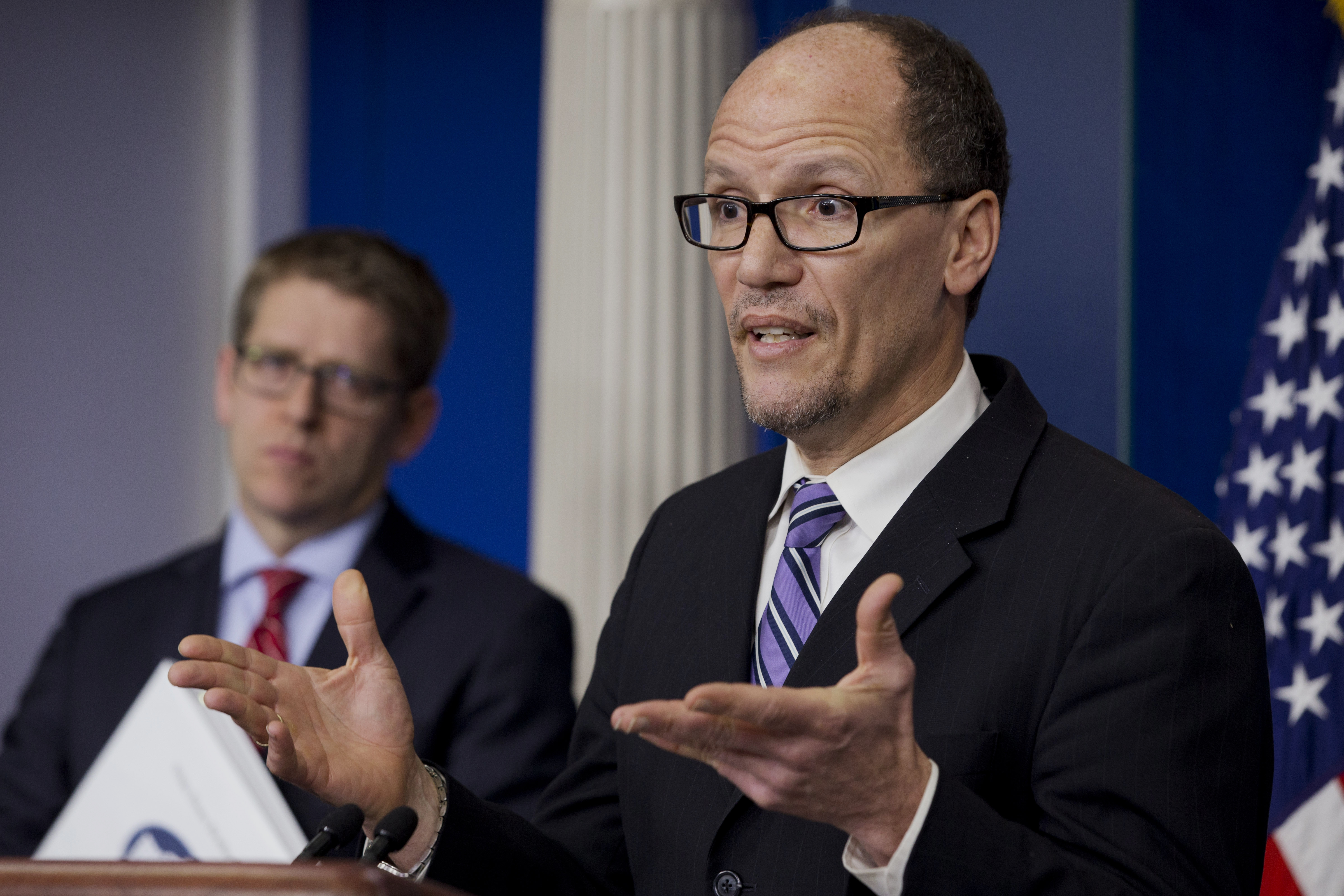 Labor Secretary Thomas Perez, right, accompanied by White House press secretary Jay Carney, speaks about the minimum wage increase for federal contract workers which will go into effect next year, Wednesday, Feb. 12, 2014, at the White House in Washington. (AP Photo/Jacquelyn Martin)