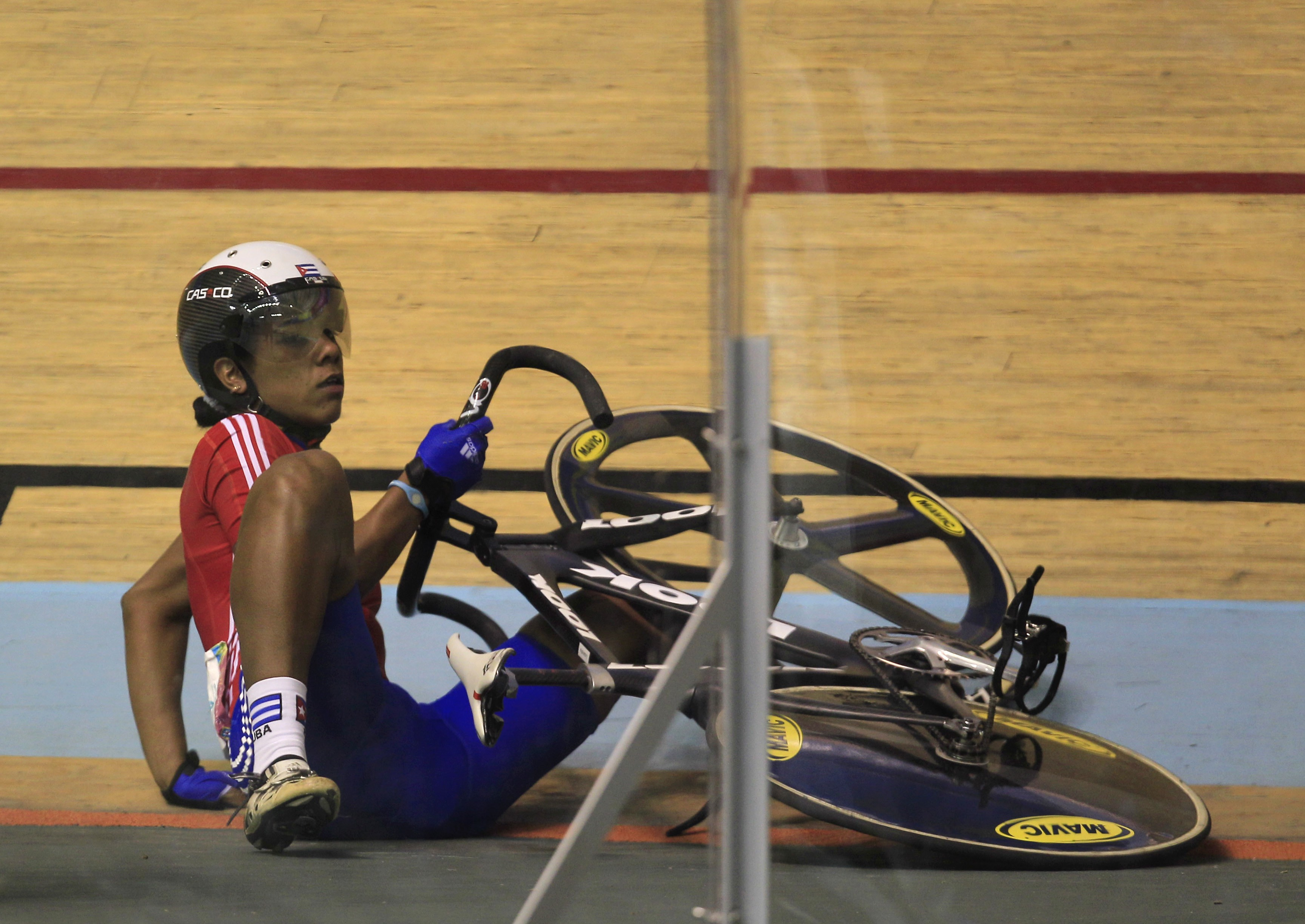Cuba's Lisandra Guerra lies on the track after falling during the cycling women's keirin final at the Pan American Games in Guadalajara, Mexico, Thursday, Oct. 20, 2011. (AP Photo/Martin Mejia)