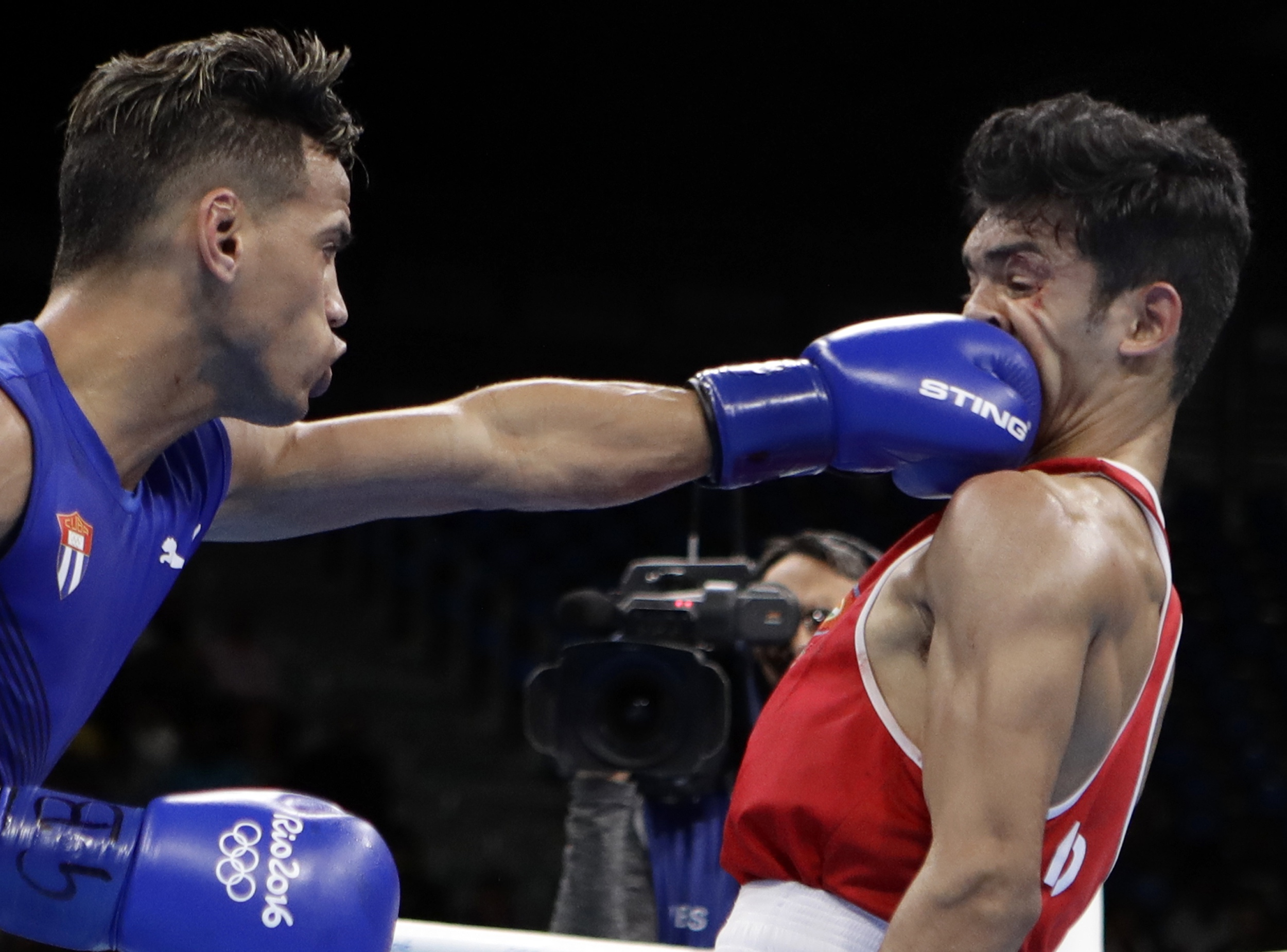Cuba's Robeisy Ramirez, left, fights India's Shiva Thapa during a men's bantamweight 56-kg preliminary boxing match at the 2016 Summer Olympics in Rio de Janeiro, Brazil, Thursday, Aug. 11, 2016. (AP Photo/Frank Franklin II)