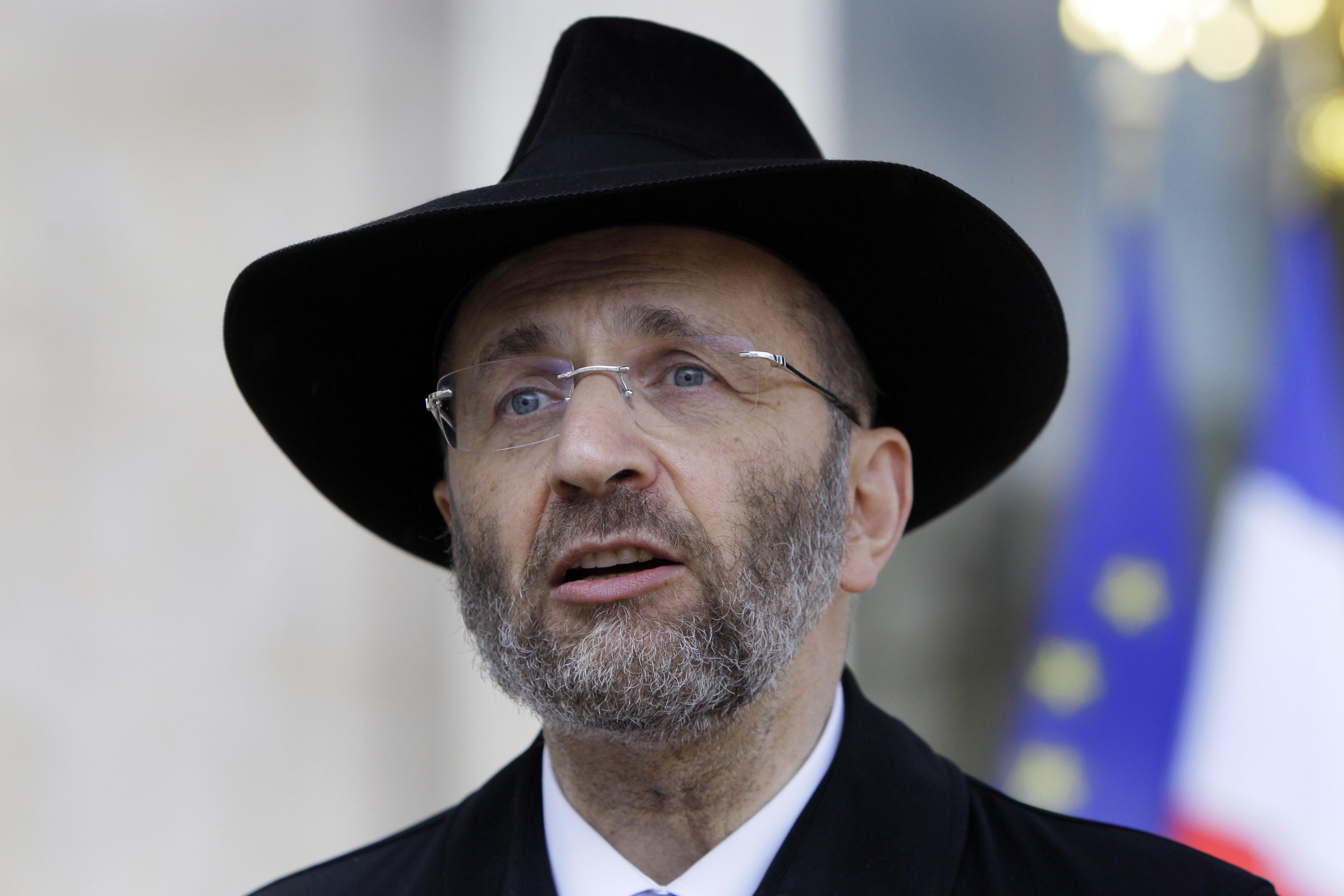 """FILE - In this July 12, 2012 file photo, France's Grand Rabbi Gilles Bernheim talks to the media after his meeting with French President Francois Hollande at the Elysee Palace in Paris. French Jewish leaders were holding an urgent meeting to discuss the career fate of France's chief rabbi Bernheim after he acknowledged """"mistakes"""" amid allegations that he plagiarized texts and lied about his educational background.(AP Photo/Francois Mori, File)"""