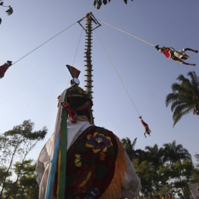 FILE - In this March 25, 2013 file photo, young Papantla Flyers from the ages of 8 to 13 perform at the Takilhsukut park as part of the Cumbre Tajin 2013 music festival celebrations in Papantla, Mexico. The Papantla Flyers perform an ancient religious ceremony from central Mexico as a prayer to the God of Sun, but now is mostly performed for tourists. (AP Photo/Felix Marquez, File)