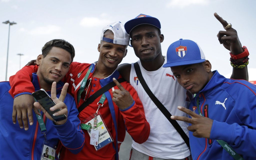 Cuban boxers, from left, Robeisy Ram'rez, Roniel Iglesias, Julio Cesar La Cruz, and Joahnys Argilagos poses at Athletes Village atthe 2016 Summer Olympics in Rio de Janeiro, Brazil, Thursday, Aug. 4, 2016. (AP Photo/Robert F. Bukaty)