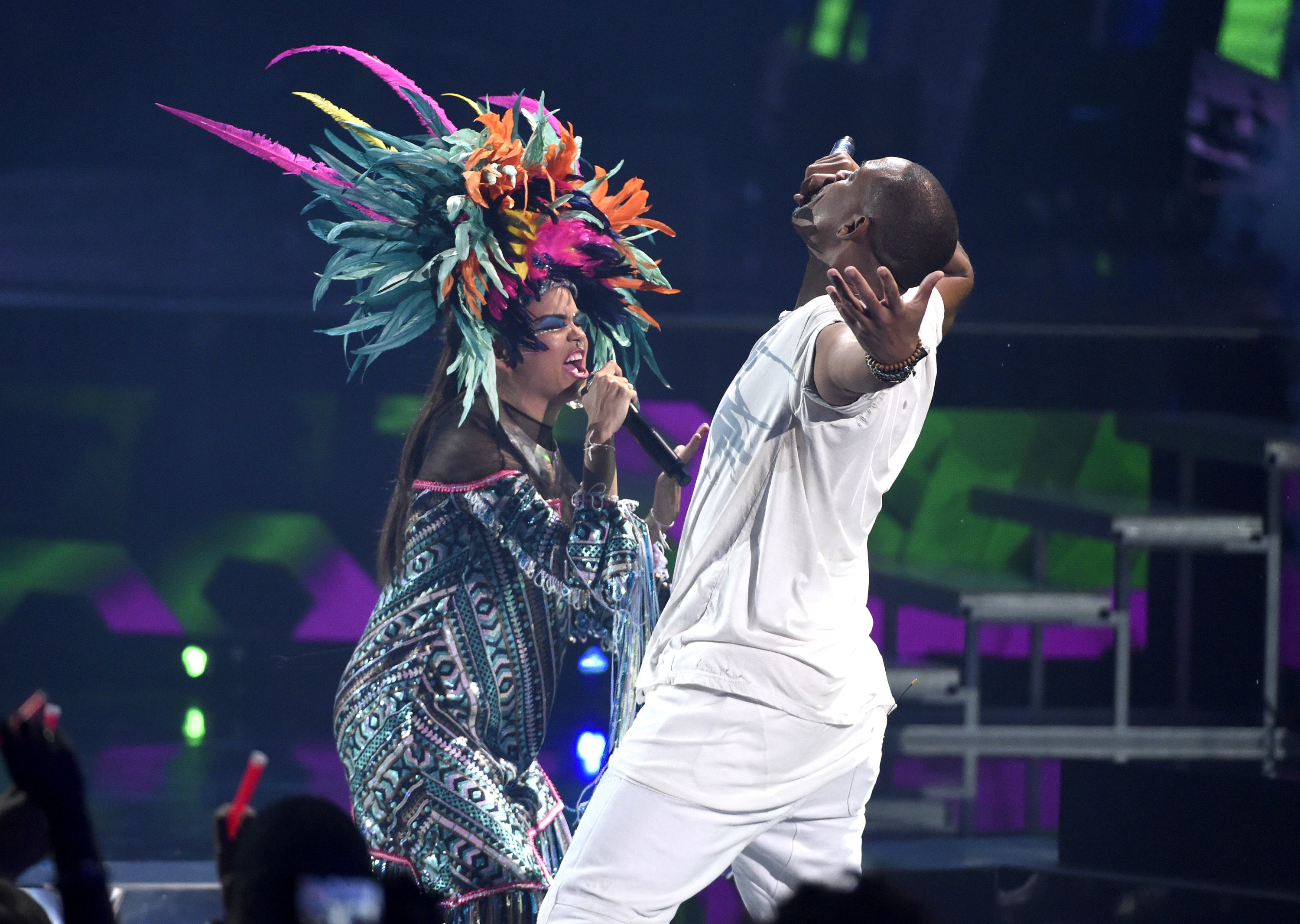 """Liliana Saumet, of Bomba Estereo, and Will Smith perform """"Fiesta"""" at the 16th annual Latin Grammy Awards at the MGM Grand Garden Arena on Thursday, Nov. 19, 2015, in Las Vegas. (Photo by Chris Pizzello/Invision/AP)"""