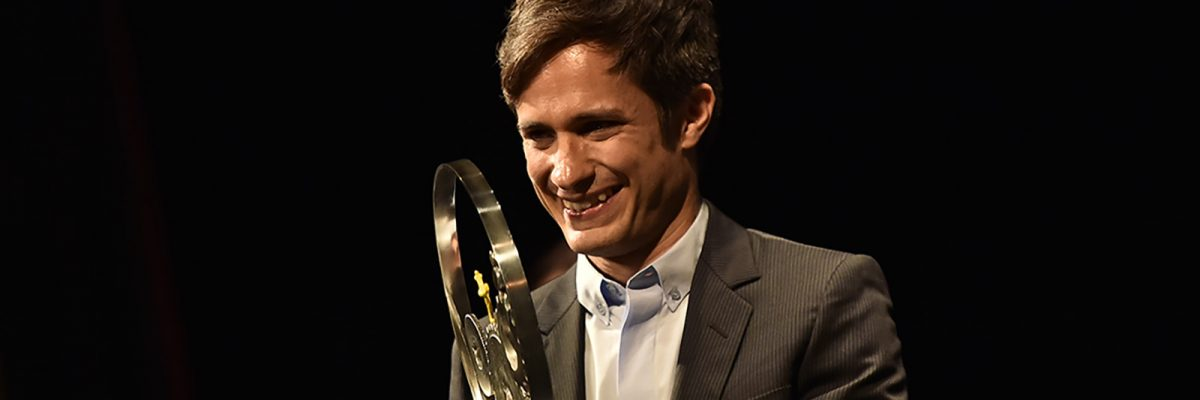 Mexican actor, Gael Garcia Bernal,, left, receives Latin American Film Jaeger-Le Coultre Award for his contribution to the Latin American cinema, for the San Sebastian Film Festival, in San Sebastian, northern Spain, Saturday, Sept. 17, 2016. The festival is one of the most prestigious and internationally recognized in Spain and Latin America. (AP Photo/Alvaro Barrientos)