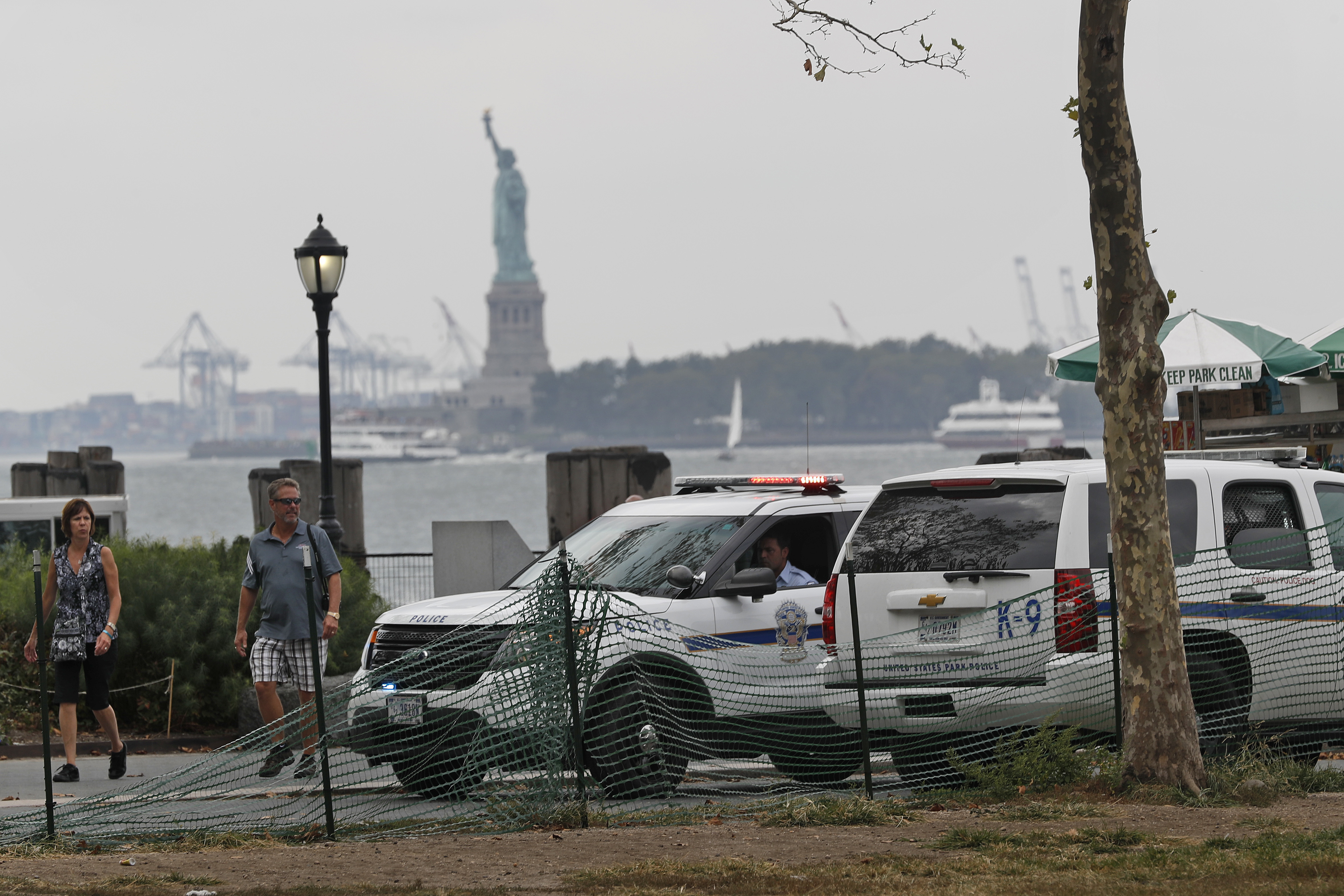 United States Parks Dept. police patrol Battery Park near the ferry entrance to the Statue of Liberty, Sunday, Sept. 18, 2016, in New York. Gov. Cuomo said 1,000 additional law enforcement officers were being deployed after the Saturday night blast in Chelsea, a primarily residential neighborhood on Manhattan's west side that's known for its art galleries and large gay population. He encouraged New Yorkers to go about their day as usual.(AP Photo/Mary Altaffer)