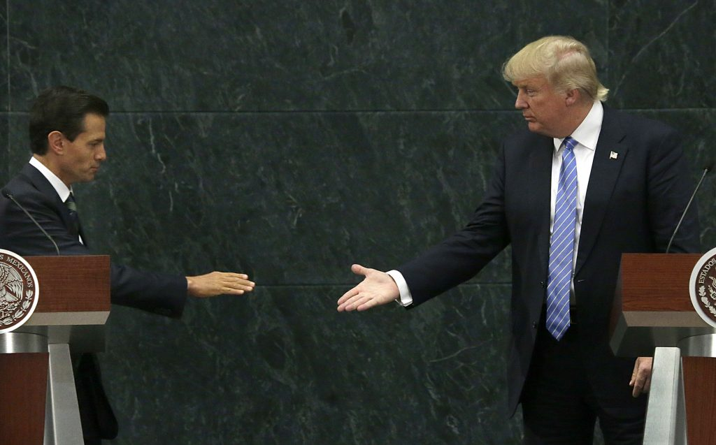Mexico's President Enrique Pena Nieto and Republican presidential nominee Donald Trump shake hands after a joint statement at Los Pinos, the presidential official residence, in Mexico City, Wednesday, Aug. 31, 2016. Trump is calling his surprise visit to Mexico City a 'great honor.' The Republican presidential nominee said after meeting with Pena Nieto that the pair had a substantive, direct and constructive exchange of ideas.(AP Photo/Marco Ugarte)