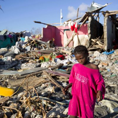 A girl walks through the debris of houses after the Hurricane Matthew in Jeremie, Haiti. Wednesday Oct. 12, 2016. People throughout Haiti's devastated southwest peninsula were forming makeshift brigades and helping each other regain some semblance of their pre-hurricane lives as they grew increasingly angry about the delay in aid for remote communities more than a week after the Category 4 storm hit. (AP Photo/Dieu Nalio Chery)