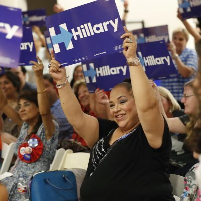 Erika Jaramillo, center, and others hold signs supporting Democratic presidential candidate Hillary Clinton during a Democratic National Convention watch party in San Antonio on Tuesday, July 26, 2016. In Texas, where 39 percent of the population is Hispanic, Democrats have been shut out of statewide elections for decades. During 2014's midterm elections, fewer than 2.3 million Texas Hispanics reported being registered to vote, or about 46 percent of the nearly 4.9 million who were eligible, according to U.S. Census Bureau surveys. (AP Photo/Eric Gay)