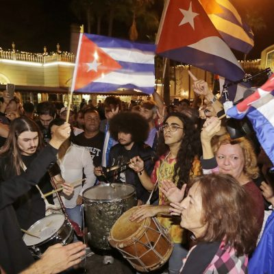 Cuban-Americans celebrate the death of Fidel Castro, Saturday, Nov. 26, 2016, in the Little Havana area in Miami. Castro died eight years after ill health forced him to formally hand power over to his younger brother Raul, who announced his death late Friday, Nov. 25, 2016, on state television. (AP Photo/Alan Diaz)