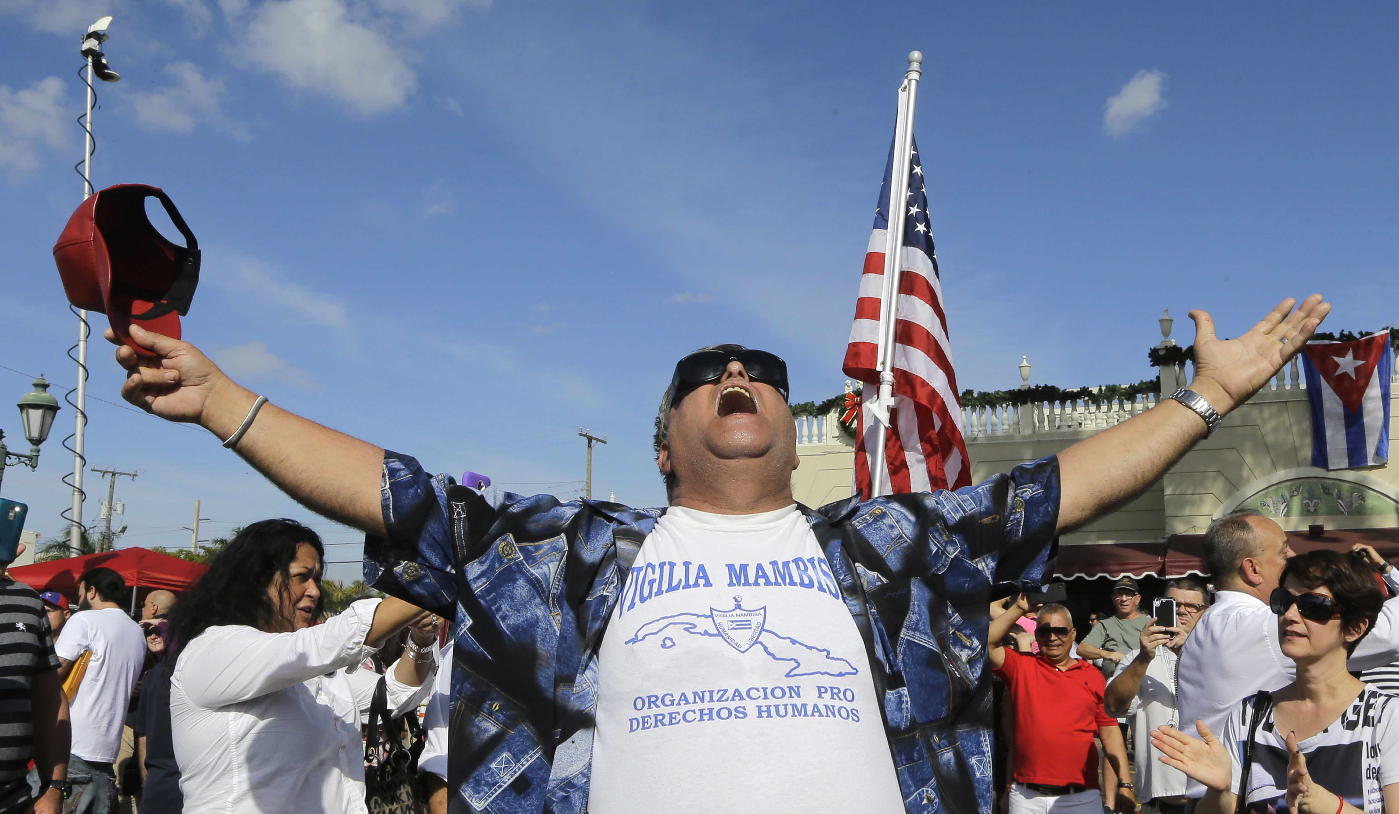 A members of the Cuban community reacts to the death of Fidel Castro, Saturday, Nov. 26, 2016, in the Little Havana area in Miami. Castro, who led a rebel army to improbable victory in Cuba, embraced Soviet-style communism and defied the power of 10 U.S. presidents during his half century rule, died at age 90. (AP Photo/Alan Diaz)