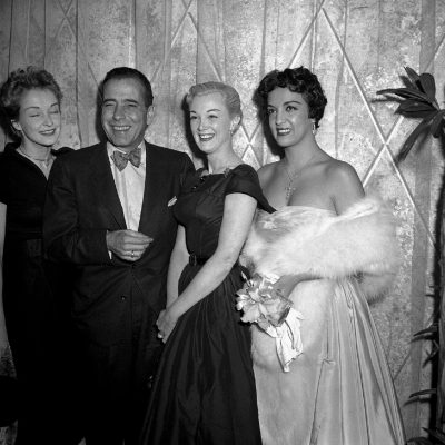 Exchanging mutual congratulations after they were nominated for Academy Awards in Hollywood, Feb. 12, 1955, left to right are: Nina Foch, Humphrey Bogart, Jan Sterling and Katy Jurado.  Bogart was nominated for the best actor award for his role as the fiendish Capt. Queeg in