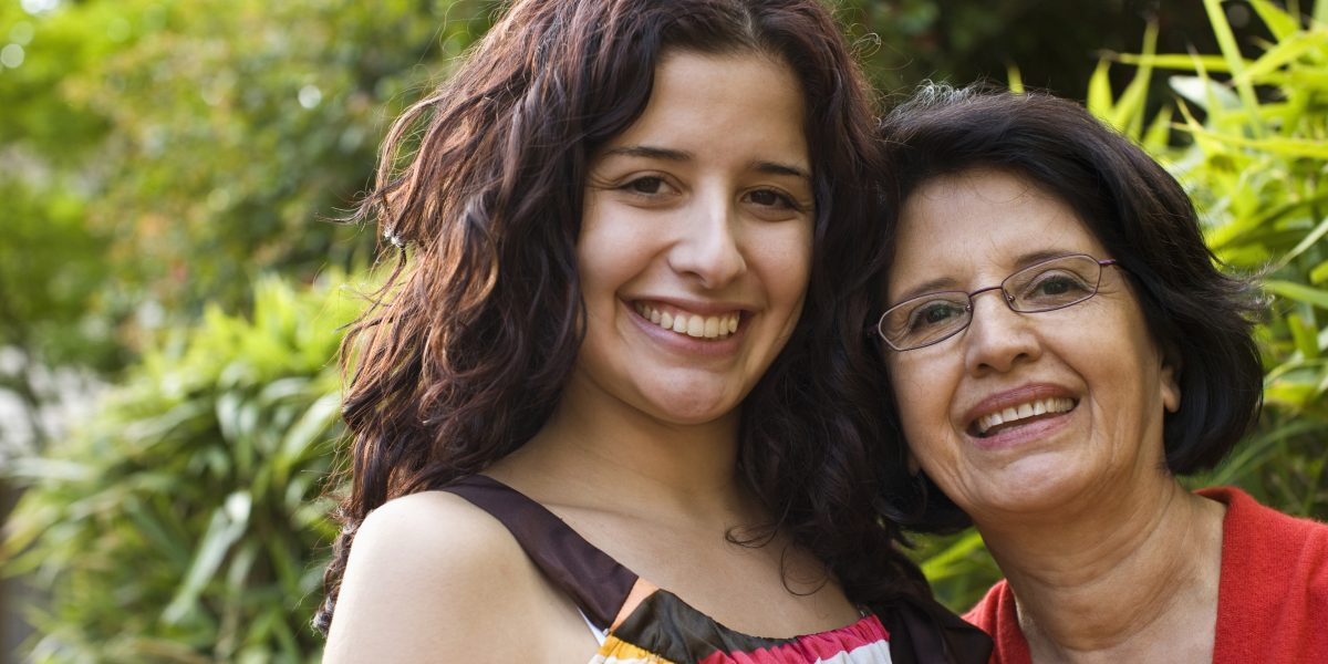 portrait of hispanic mother and daughter